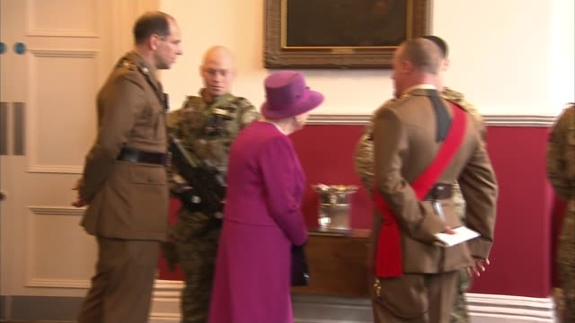 queen visits royal welsh regiment at lucknow barracks; st david's day: queen visits royal welsh regiment at lucknow barracks; int queen elizabeth ii... - sports glove stock videos & royalty-free footage