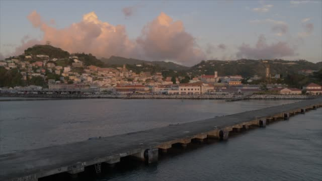 st. george's at sunset from cruise ship leaving port, grenada, windward islands, west indies, caribbean, central america - st. george's grenada stock videos and b-roll footage