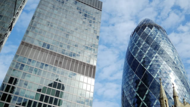 st helen's and the gherkin skyscrapers in the city of london - city of london stock videos & royalty-free footage
