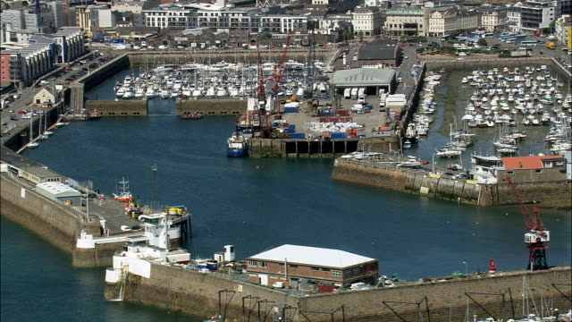 st helier harbour  - aerial view - helicopter filming,  aerial video,  cineflex,  establishing shot,  jersey - channel islands england stock videos & royalty-free footage