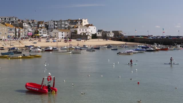 st ives harbour at high tide, cornwall, uk. - craft stock videos & royalty-free footage