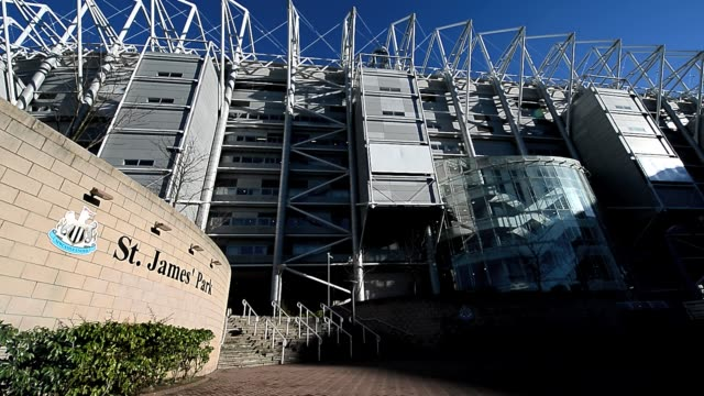 st james' park exterior pan shot clean fans arrive at st james' park home to newcastle united football club in newcastle upon tyne february 2 2013... - st. james' park newcastle upon tyne stock videos & royalty-free footage