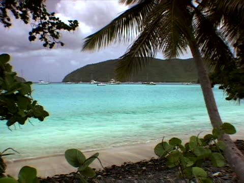 st. john: boats in the bay at maho beach - artbeats stock videos & royalty-free footage