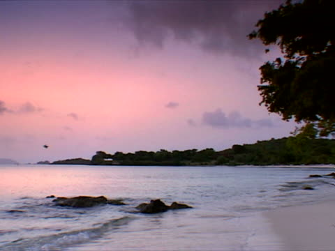 st. john: pink sunset water at paradise beach - artbeats stock videos & royalty-free footage