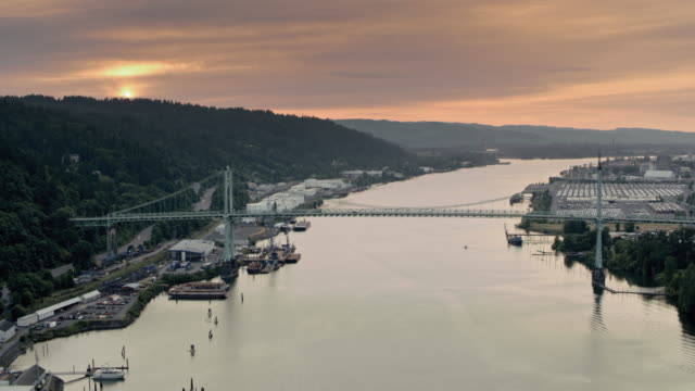 AERIAL St. Johns Bridge across Willamette River at sunset