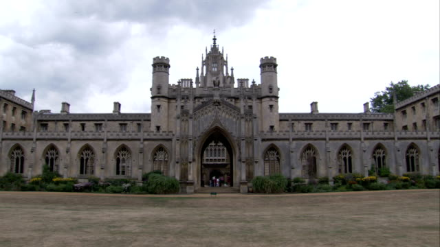 st john's college in cambridge features rows of gothic arches. available in hd. - cambridge university stock videos and b-roll footage