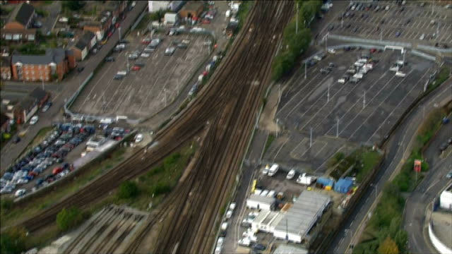 aerials of south east and london england kent of tonbridge station stationary train on tracks / commuters waiting on platform / stationary trains /... - railway track stock videos & royalty-free footage