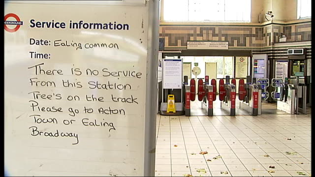 vídeos de stock, filmes e b-roll de travel disruption alison nolan interview sot ealing common station rail worker and two people at station entrance service information sign at ealing... - biruta