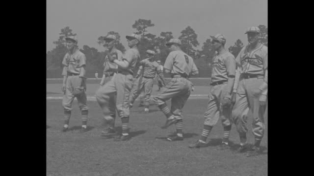 St Louis Cardinals baseball team runs onto field during spring training in Daytona Beach FL / CU manager Frankie Frisch / players stand in row...