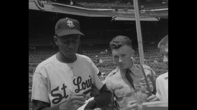 St Louis Cardinals pitcher Satchel Paige signs autographs for fans at baseball's AllStar Game in Cincinnati OH / montage 2shots Billy Pierce left...