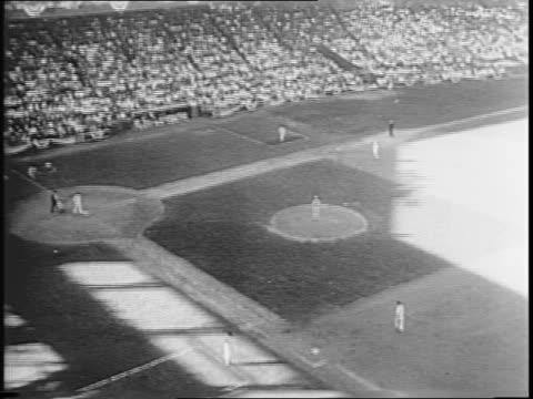 st louis cardinals versus st louis browns / ken o'dea batting / baseball diamond while players run bases / george mcquinn hitting ball / woman... - sportlerin stock-videos und b-roll-filmmaterial