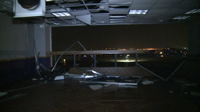 st louis lambert airport heavily damaged by powerful tornado/ workers clean up shattered glass and other debris tornado damage hits midwest on may 05... - 2011 stock videos & royalty-free footage