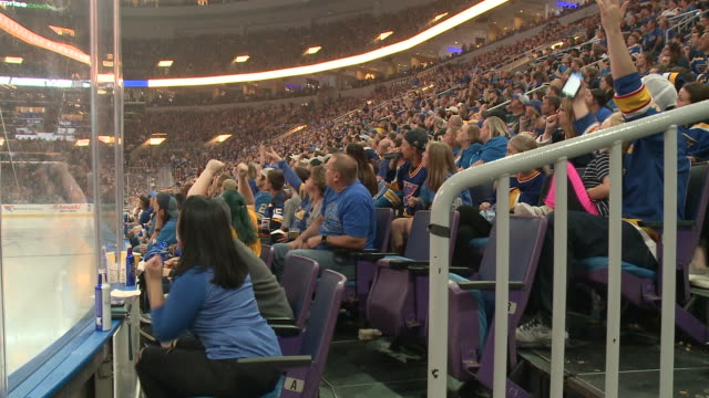 st. louis, mo, u.s. - st. louis blues fans cheering while watching the broadcast of stanley cup game 7 from enterprise center as the blues beat the... - broadcasting stock videos & royalty-free footage
