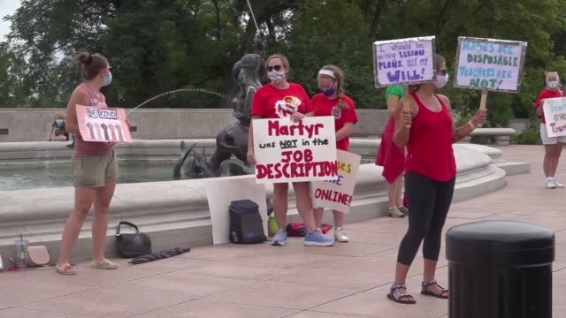 st. louis, mo, u.s. - teachers protesting. dozens of teachers gathered outside the capitol in jefferson city today to protest against going back into... - {{relatedsearchurl(carousel.phrase)}} video stock e b–roll
