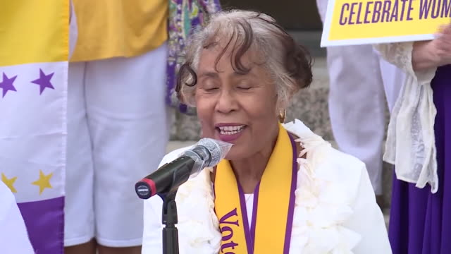 st. louis, mo, u.s. - women standing with yellow umbrellas behind speaker. league of women voters of metro st. louis co-presidents nancy miller and... - western script stock videos & royalty-free footage
