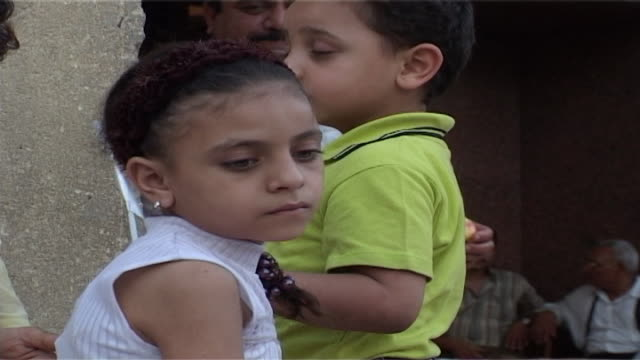 st mark's festival cu on a young girl with braided hair and a young boy carrying a festival flag behind her - braided hair stock videos & royalty-free footage