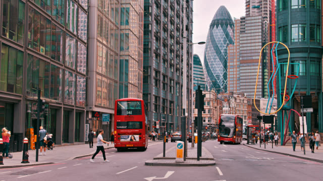 30 st mary axe, the gherkin building in business district. red bus. tourism and business. - pedestrian stock videos & royalty-free footage