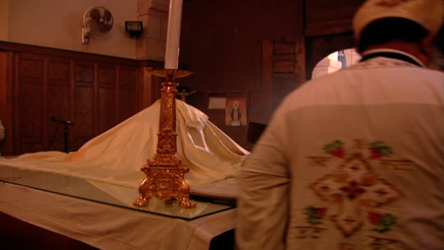 st. mary orthodox church. view of a priest circling an altar performing a censing and swinging a thurible. circumambulation is the act of moving... - swinging stock videos & royalty-free footage