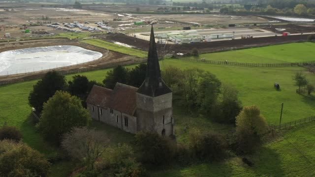 st. mary's church in sevington near a new brexit customs clearance centre, being constructed off the m20 motorway on october 19 in ashford, kent. the... - major road stock videos & royalty-free footage