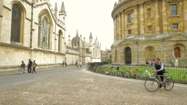 st marys church,radcliffe square, oxford,bikes - oxford university stock videos & royalty-free footage
