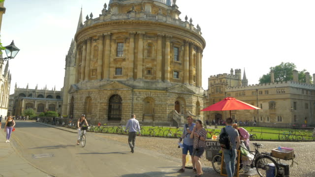 st marys church,radcliffe square, oxford,bikes - oxford england stock videos and b-roll footage