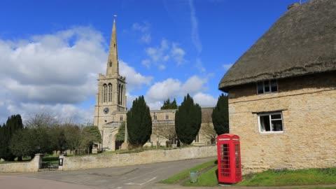 st nicholas church, bulwick village, northamptonshire, england, britain, uk - telefonzelle stock-videos und b-roll-filmmaterial