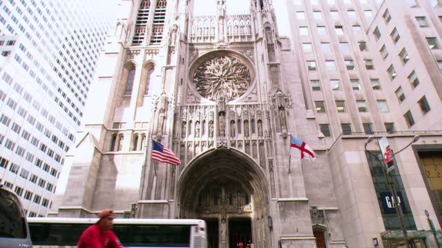 td st. patrick's cathedral entrance, with pedestrians and traffic / new york city, new york, united states - st. patrick's cathedral manhattan stock videos and b-roll footage