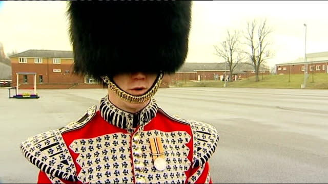 st patrick's day duchess of cambridge distributes shamrocks to irish guards drummer oliver vaughey interview sot polished his collar brushed him this... - collar stock videos & royalty-free footage