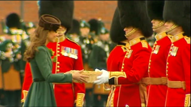 duchess of cambridge distributes shamrocks to irish guards; england: hampshire: aldershot: ext catherine, duchess of cambridge , presents trays of... - zweig stock-videos und b-roll-filmmaterial
