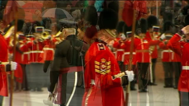 duchess of cambridge distributes shamrocks to irish guards; england: hampshire: aldershot barracks: ext catherine, duchess of cambridge out of car... - itv weekend late news点の映像素材/bロール