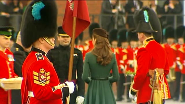 duchess of cambridge distributes shamrocks to irish guards; england: hampshire: aldershot: mons barracks: ext **military band and piper heard**... - aldershot stock videos & royalty-free footage