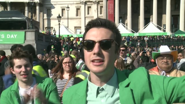 st patrick's day london parade england london trafalgar square ext sun shining over nelson's column tilt down st patrick's day celebrations crowd... - down jacket stock videos and b-roll footage