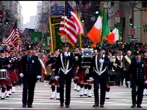 st. patrick's day parade, saturday, march 16, 2002- bagpipe & drum band leading galway fdny contingent, many wearing kilts. officers carry american &... - marching stock videos & royalty-free footage