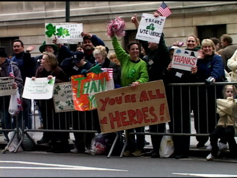 st patrick's day parade saturday march 16 2002 group of female holy trinity high school students hold up sign reading 200 claddagh rings found at... - other stock videos & royalty-free footage