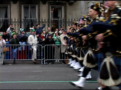 st. patrick's day parade, saturday, march 16, 2002- port authority police bagpipe & drum band in kilts w/ american flags march past spectators.... - bagpipes stock videos & royalty-free footage