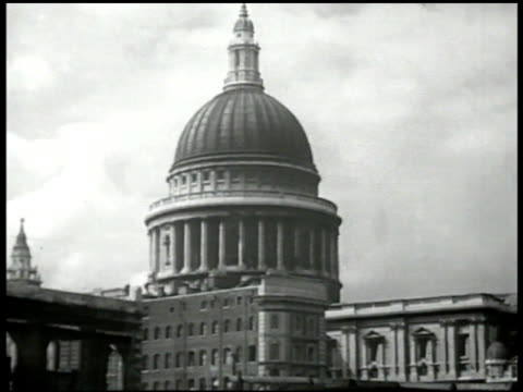 st paul's cathedral in london ruins fg ws church building destroyed cars passing fg ws city of london possibly financial building bg la ws bank of... - financial building stock videos and b-roll footage
