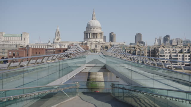 st paul's cathedral over the millennium bridge - empty london in lockdown during coronavirus pandemic - strada vuota video stock e b–roll