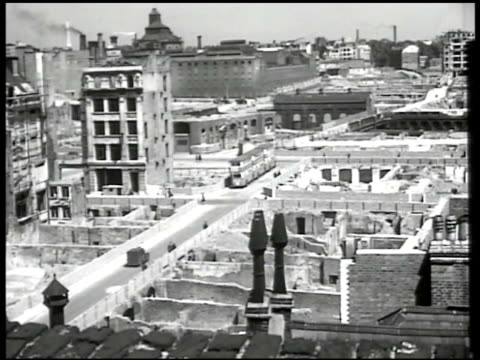 st paul's cathedral, ruins fg. london streets, destroyed buildings. construction machine digging rubble, st paul's cathedral bg. worker operating... - st. paul's cathedral london stock videos & royalty-free footage