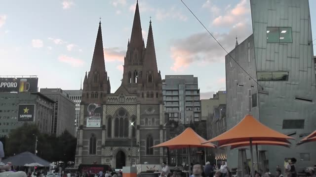 St Paul's Cathedral with Federation Square and people in foreground of shot