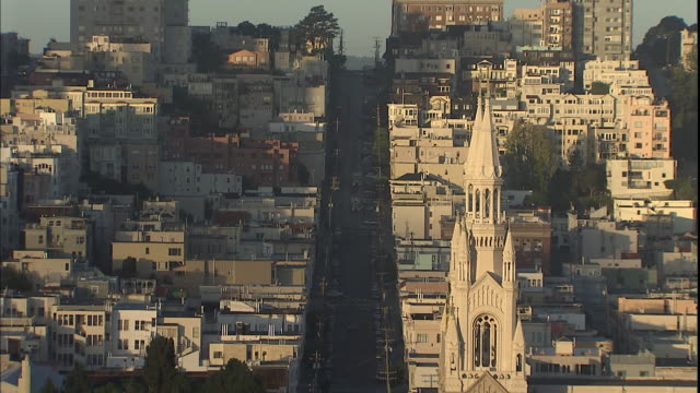 st. peter and paul church towers over a san francisco street. - north beach san francisco stock videos and b-roll footage