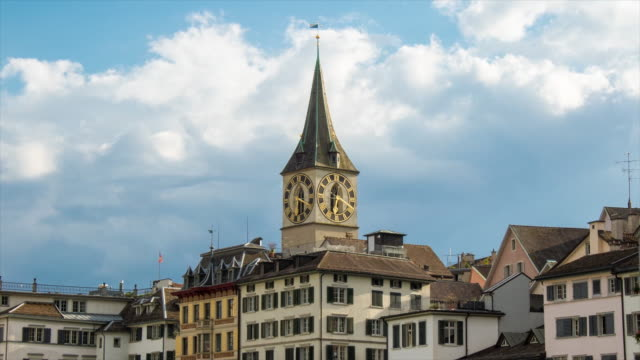 st. peter church of zurich, switzerland. 4k timelapse - turmuhr stock-videos und b-roll-filmmaterial
