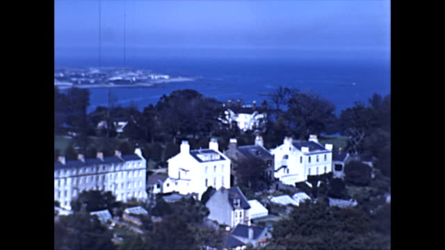 st peter port guernsey harbour and town - early colour footage elevated view - guernsey stock-videos und b-roll-filmmaterial