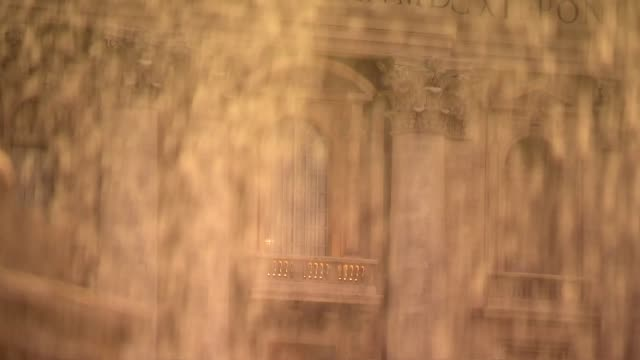 st. peter's basilica facade behind water - st peter's square stock videos & royalty-free footage