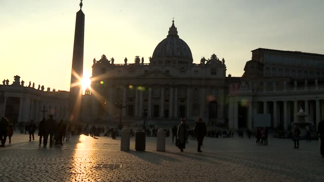 st peter's square people milling about and st peter's basilica at dusk vatican city - state of the vatican city stock videos & royalty-free footage