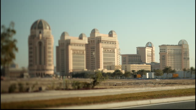 st. regis hotel, doha, qatar. view of domed towers of the five-star st. regis hotel in west bay using tilt-shift lens for a miniature or toy town... - doha stock videos & royalty-free footage
