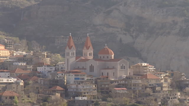 st saba cathedral bsharri lebanon zoom out from st saba cathedral nestled in the lebanese mountains - snowcapped mountain stock videos & royalty-free footage