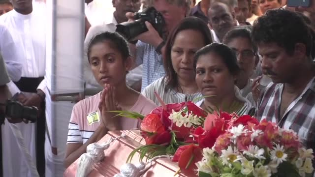 st sebastian's church holds a memorial service to honour more than 300 people who were killed in suicide bomb blasts that have been blamed on a local... - sri lanka stock videos & royalty-free footage