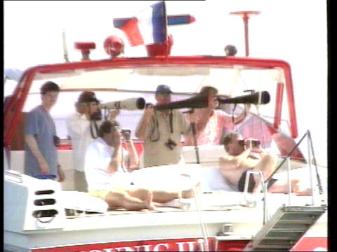 st tropez: ext **whitaker interview overlaid sot** photographers with long lenses on boat princess diana boarding luxury cruiser of al fayed end lib - ダーモット・マーナハン点の映像素材/bロール