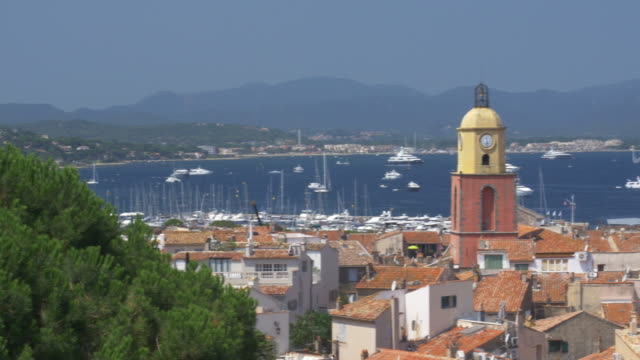 St Tropez with Church Bell tower and yachts in the distance.4K