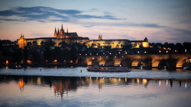 st. vitus cathedral, charles bridge and the castle district illuminated at night,  prague, czech republic - charles bridge stock videos & royalty-free footage